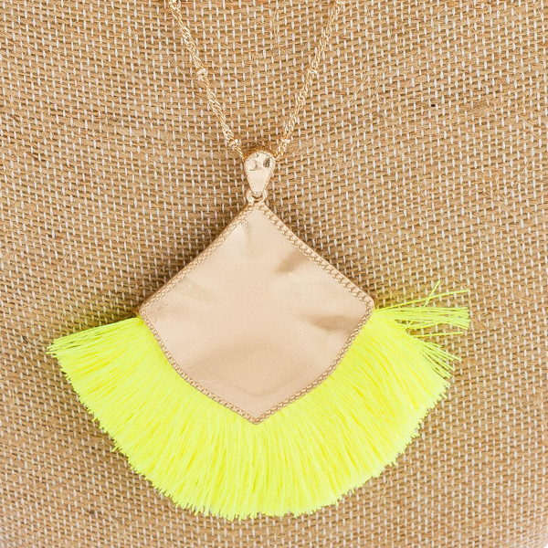 """Long satellite chain necklace featuring a metal plated pendant with neon tassel accents. Pendant approximately 3"""". Approximately 36"""" in length overall."""