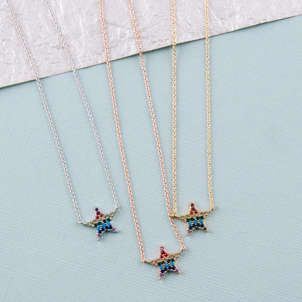 "Dainty cable chain necklace featuring a star pendant with multicolor cubic zirconia details. Pendant approximately .5"". Approximately 18"" in length overall."