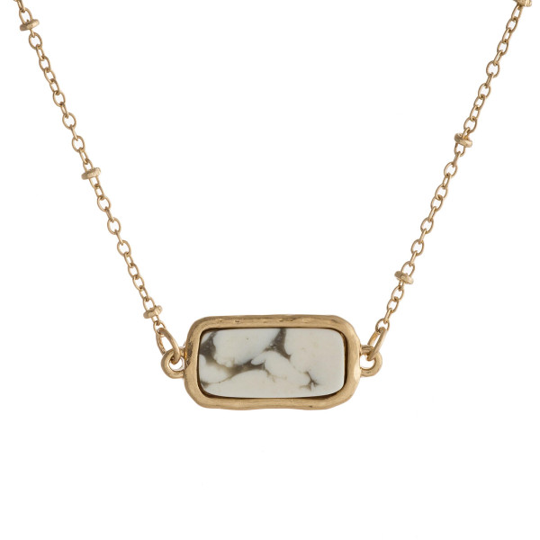 """Dainty satellite chain necklace featuring a natural stone inspired pendant. Pendant approximately .75"""" wide. Approximately 18"""" in length overall."""