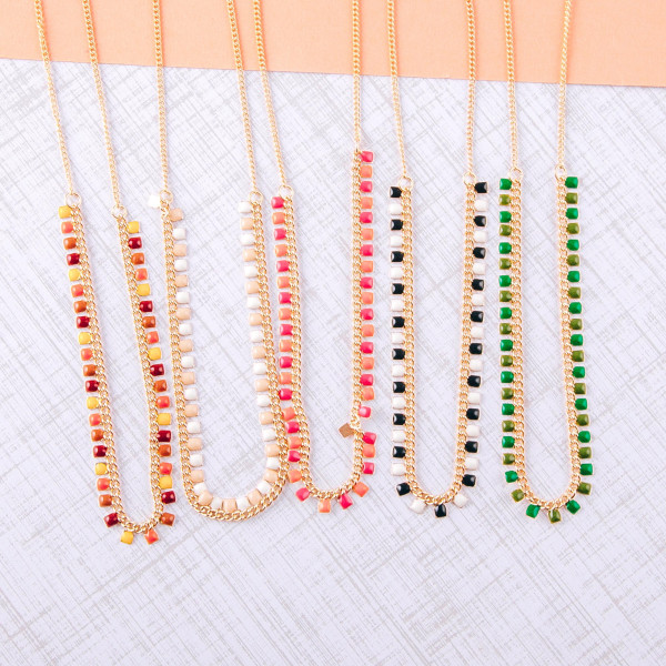 """Dainty cable chain necklace featuring enamel square accents. Approximately 16"""" in length."""