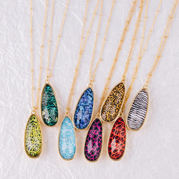 """Dainty satellite chain necklace featuring an iridescent teardrop pendant with leopard print details. Pendant approximately 1.5"""". Approximately 20"""" in length overall."""