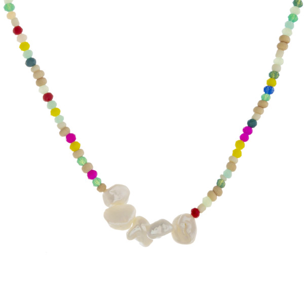 """Beaded necklace featuring seed, iridescent and wood bead details with pearl accents. Approximately 16"""" in length."""