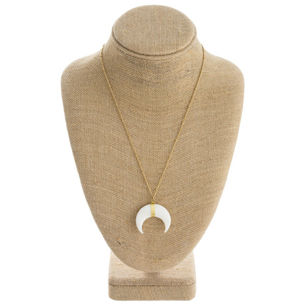 """Long satellite chain necklace featuring a crescent pendant. Pendant approximately 1.5"""" in diameter. Approximately 20"""" in length overall."""