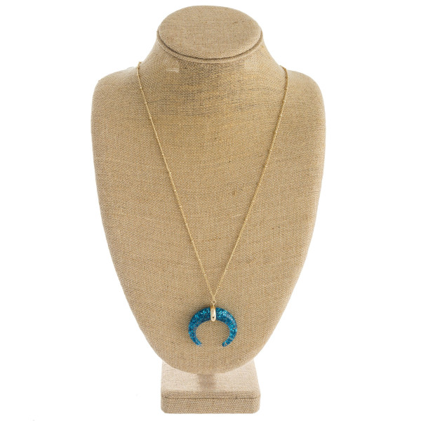 """Long satellite chain necklace featuring a glittery crescent pendant. Pendant approximately 2"""" in diameter. Approximately 36"""" in length overall."""