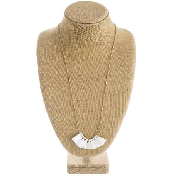 "Long link bar chain necklace featuring a raffia tassel pendant. Approximately 34"" in length."