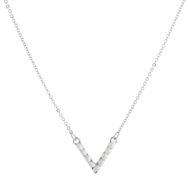"""Dainty cable chain necklace featuring a """"v"""" shaped pendant with pearl beaded details. Pendant approximately .5"""". Approximately 16"""" in length overall."""