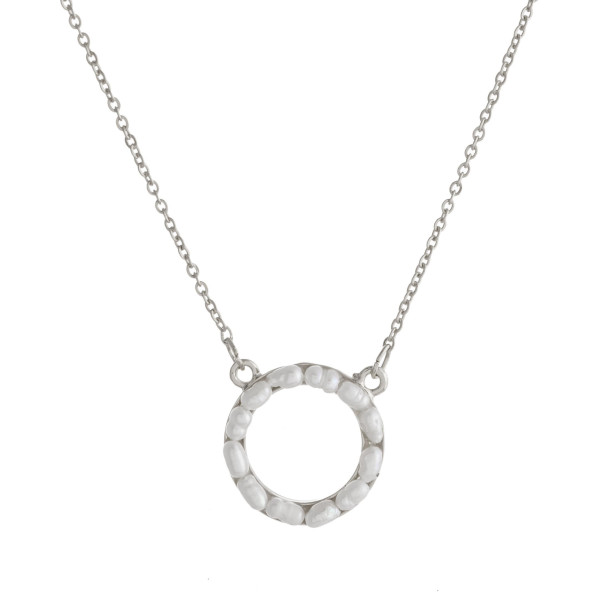 """Dainty cable chain necklace featuring a pearl beaded disc pendant. Pendant approximately .5"""" in diameter. Approximately 16"""" in length overall."""