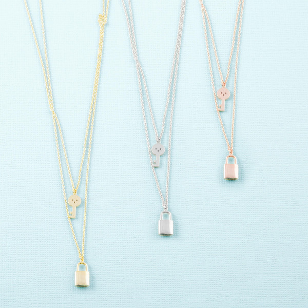 """Dainty layered cable chain necklace featuring a lock and key pendant with cubic zirconia details. Pendants approximately 1cm. Approximately 18"""" in length overall."""
