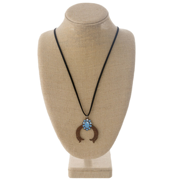 """Long western style black felt necklace featuring a horseshoe metal pendant. Pendant approximately 2.5"""". Approximately 36"""" in length overall."""