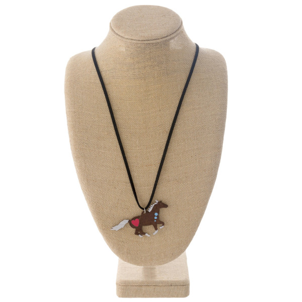 """Long western style black felt necklace featuring a horse metal pendant. Pendant approximately 2.5"""". Approximately 36"""" in length overall."""
