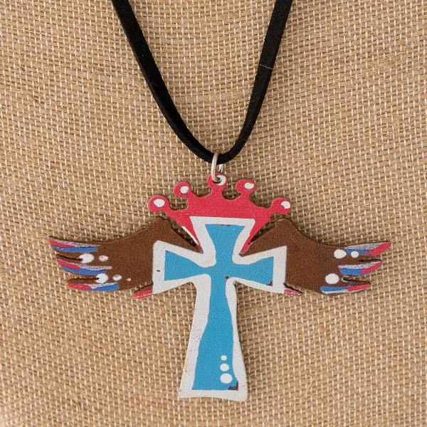 """Long western style black felt necklace featuring a cross metal pendant. Pendant approximately 2.5"""". Approximately 36"""" in length overall."""