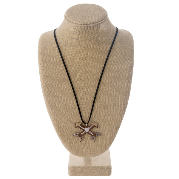 "Long western style black felt necklace featuring an arrow metal pendant. Pendant approximately 2.5"". Approximately 36"" in length overall."