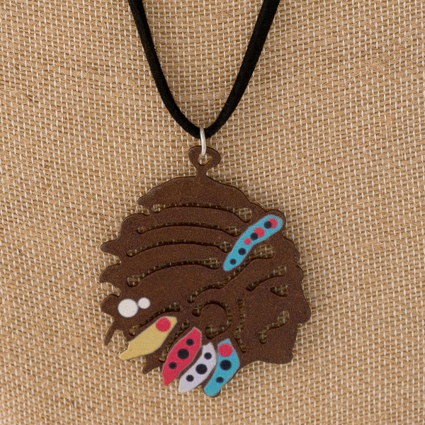 """Long western style black felt necklace featuring an Indian metal pendant. Pendant approximately 2.5"""". Approximately 36"""" in length overall."""