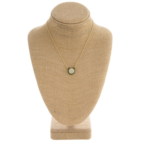 "Druzy encased pendant necklace. Pendant approximately .5"" in diameter. Approximately 16"" in length overall."