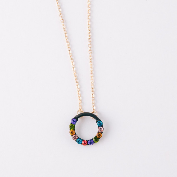"""Cable chain necklace featuring a circular pendant with multicolor rhinestone accents. Pendant approximately 2cm in diameter. Approximately 16"""" in length."""
