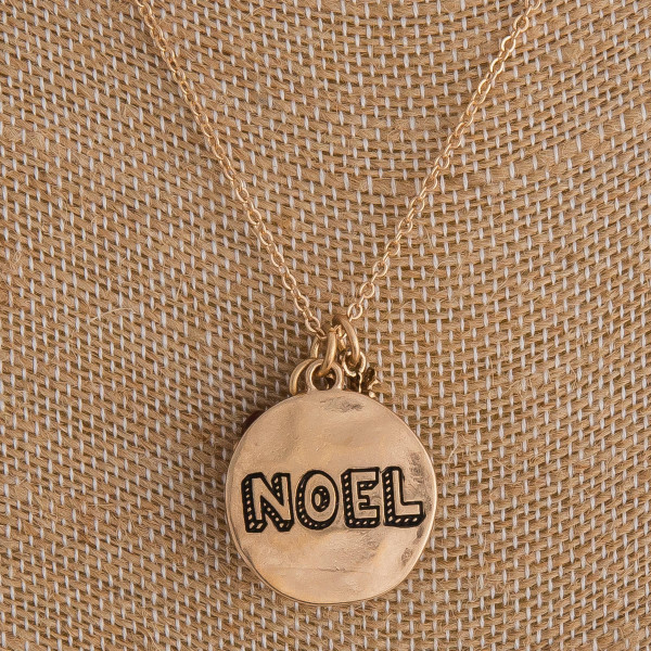 "Gold ""Noel"" engraved Christmas charm necklace. Pendant approximately 1"" in diameter. Approximately 18"" in length overall."