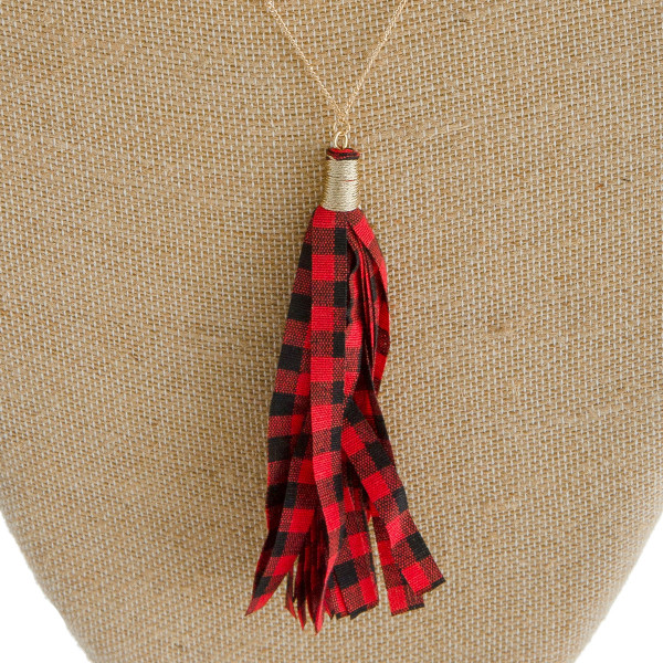 "Long satellite chain necklace featuring a fabric buffalo check tassel pendant. Pendant approximately 4.5"" in length. Approximately 38"" in length overall."