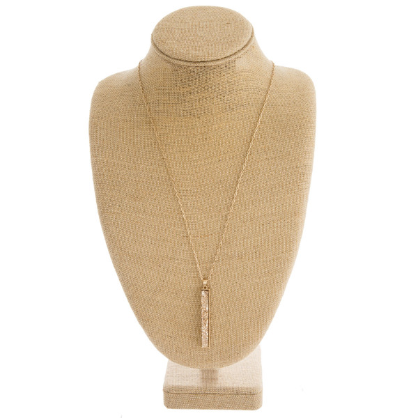 "Druzy metal encased bar pendant necklace. Pendant approximately 3"" in length. Approximately 34"" in length overall."