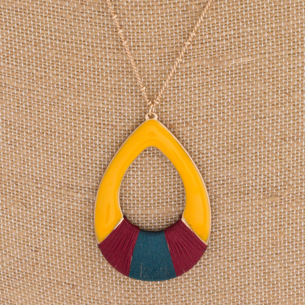 "Long enamel coated teardrop pendant necklace featuring thread wrapped details. Pendant approximately 2.5"" in length. Approximately 34"" in length overall."