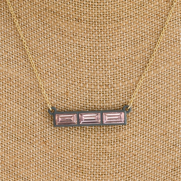 "Two ton rhinestone encased coated bar necklace. Pendant approximately 1.5"" in length. Approximately 14"" in length with a 3"" extender."