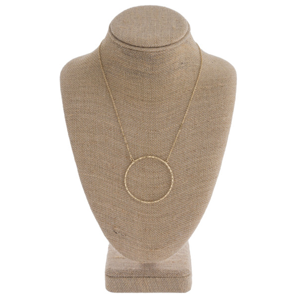 "Hammered open circle pendant necklace. Pendant approximately 2"" in diameter. Approximately 18"" in length overall."