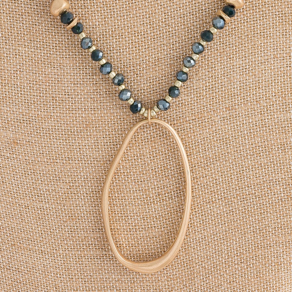 "Long Semi Precious Beaded Oval Pendant Necklace.  - Pendant 2.75""  - Approximately 36"" L  - 3"" Adjustable Extender"
