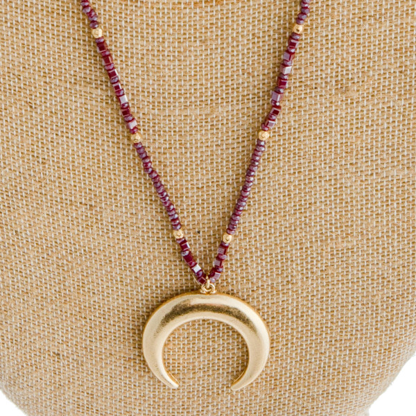 """Long dainty beaded crescent necklace. Pendant approximately 1.5"""" in diameter. Approximately 34"""" in length overall."""