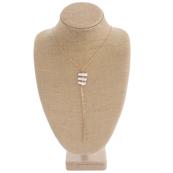 "Long pearl accented necklace featuring a chain link tassel. Approximately 41"" in length."