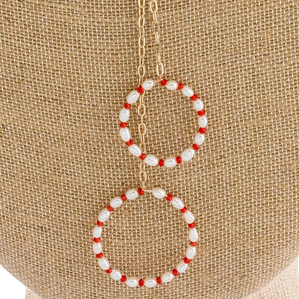 "Long double drop pearl beaded pendant necklace. Pendant approximately 6"" in length. Approximately 36"" in length overall."