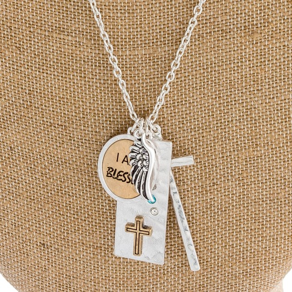 "Metal tone inspirational charm necklace featuring ""I am Blessed"" engraved details. Approximately 34"" in length."