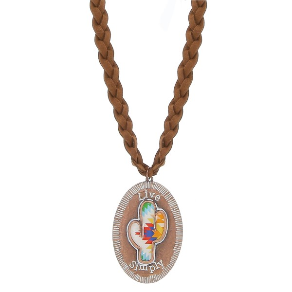 """Light Brown faux leather braided necklace featuring a copper tone cactus pendant with """"Live Simply"""" engraved details.  - Pendant approximately 2.75"""" in length - Approximately 38"""" in length overall with a 3.5"""" extender"""