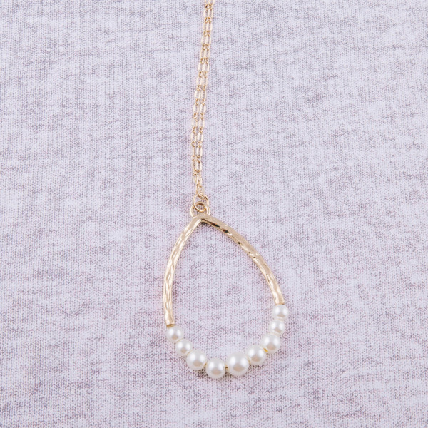 "Long hammered pearl beaded teardrop pendant necklace. Pendant approximately 2.5"" in length. Approximately 32"" in length overall."