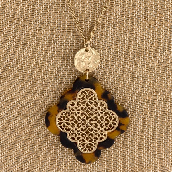 """Layered metal encased matte resin moroccan pendant necklace. Pendant approximately 3"""" in length. Approximately 34"""" in length overall."""