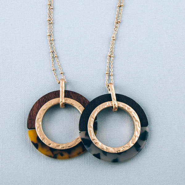 """Long resin and wood open circle pendant necklace. Pendant approximately 2.25"""" in diameter. Approximately 36"""" in length overall."""