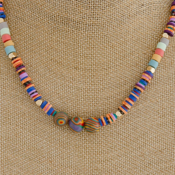 "Spacer beaded necklace with natural stone details.  - Approximately 14"" in length with 3"" extender"