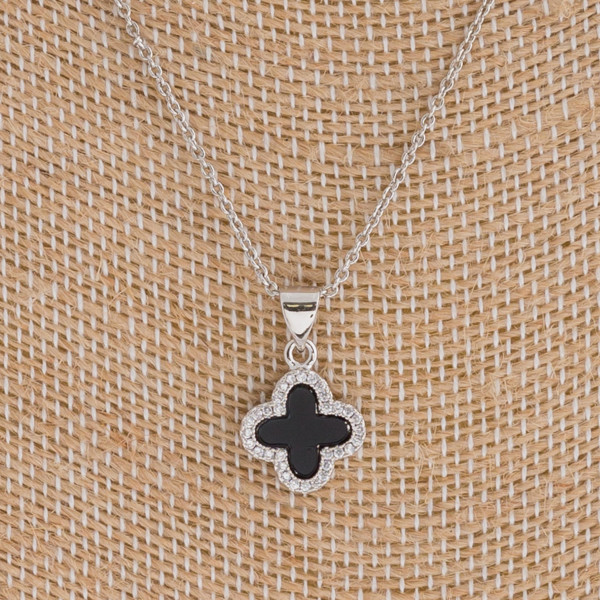 """Dainty resin clover pendant featuring cubic zirconia details. Pendant 1cm in diameter. Approximately 16"""" in length overall."""