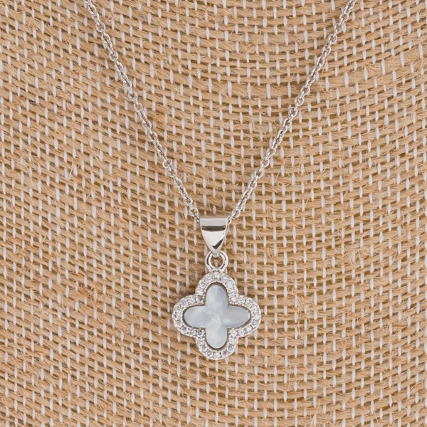 """Dainty resin clover pendant featuring cubic zirconia details. Pendant approximately 1cm in diameter. Approximately 16"""" in length."""