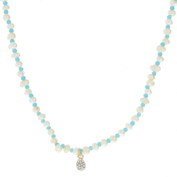 "Pearl beaded necklace featuring a dainty rhinestone pendant.  - Pendant approximately 7mm long - Approximately 14"" in length overall with 3.5"" extender"