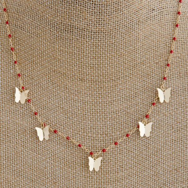 "Dainty enamel color coated butterfly necklace.   - Approximately 16"" in length"