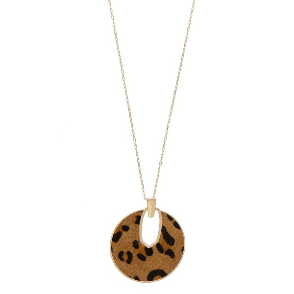 "Cowhide leopard print encased disc pendant necklace.  - Pendant approximately 2.5"" in diameter - Approximately 34"" in length overall"