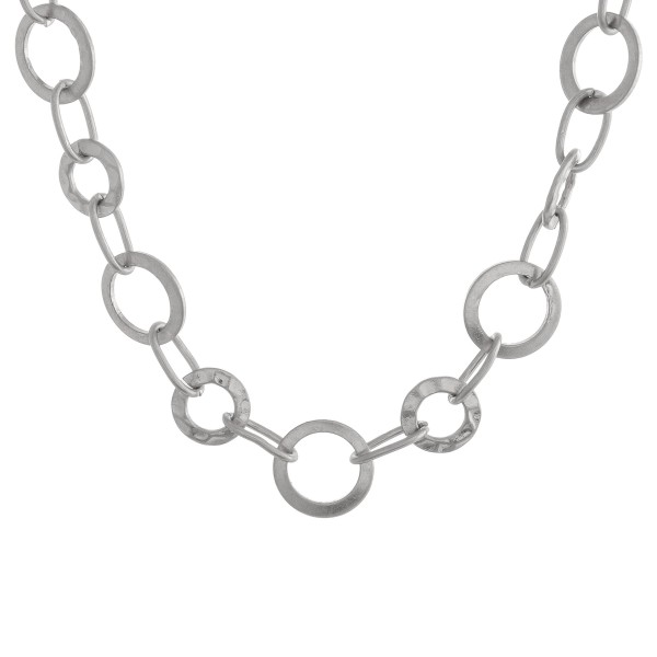 "Short metal disc linked necklace.  - Approximately 12"" in length with 3"" extender"
