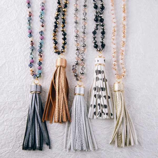 """Long beaded faux leather tassel pendant statement necklace.  - Pendant approximately 4"""" in length - Approximately 38"""" in length overall"""