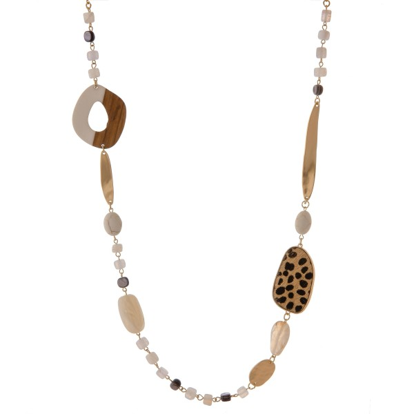 """Semi precious beaded geo linked statement necklace with cowhide leopard print details.  - Approximately 36"""" in length"""