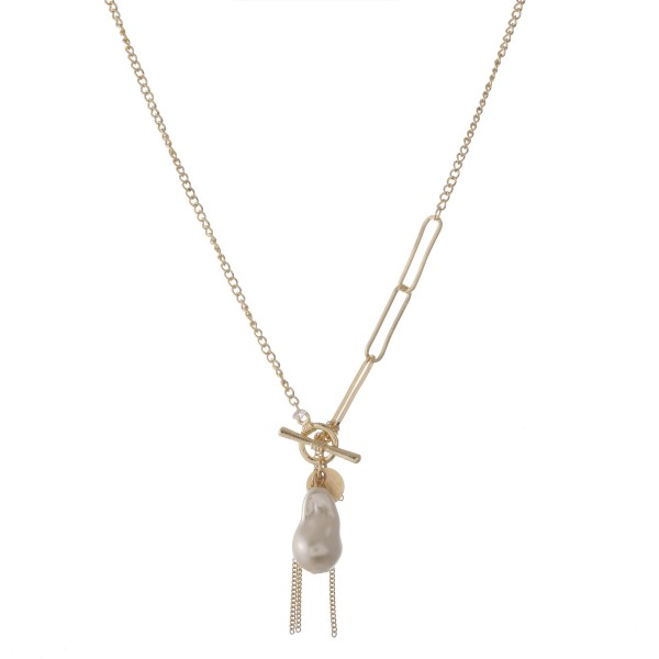 "Faux pearl tassel charm pendant toggle clasp necklace.  - Approximately 20"" in length"