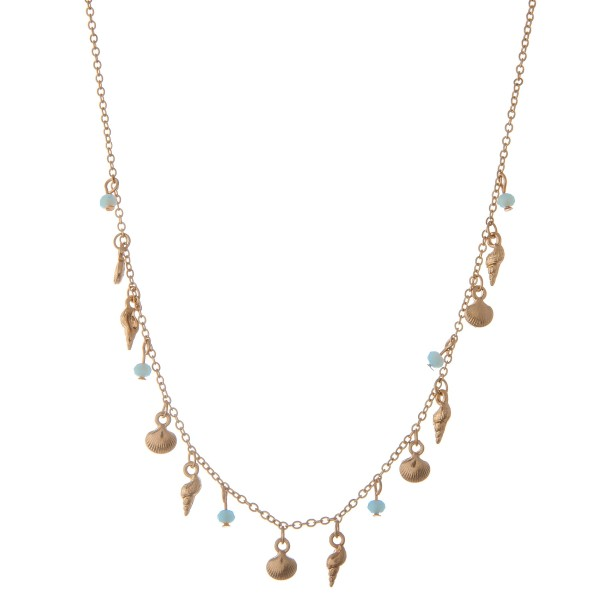 """Dainty seashell beaded floater necklace.  - Approximately 15"""" L  - 3"""" extender"""