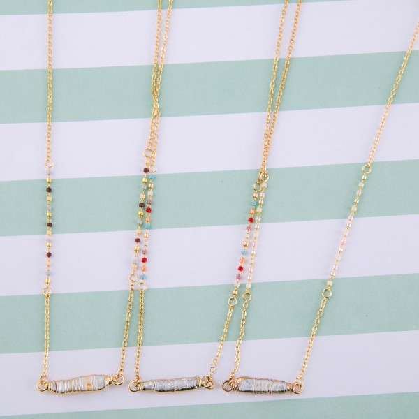 """Dainty seed beaded pearl bar necklace.  - Pendant approximately 1"""" in length - Approximately 14"""" in length overall with 3"""" extender"""