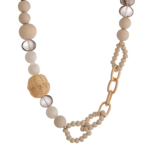 "Ivory wood geometric beaded statement necklace with raffia and faux pearl details.  - Bead size approximately 14mm  - Approximately 18"" in length with 3"" extender"