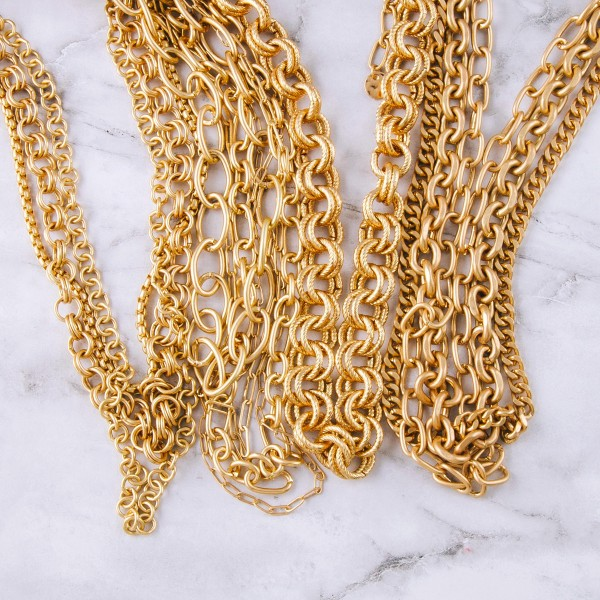 "Gold chain linked layered necklace.  - Shortest layer approximately 14"" in length  - Approximately 18"" in length overall with 3"" extender"