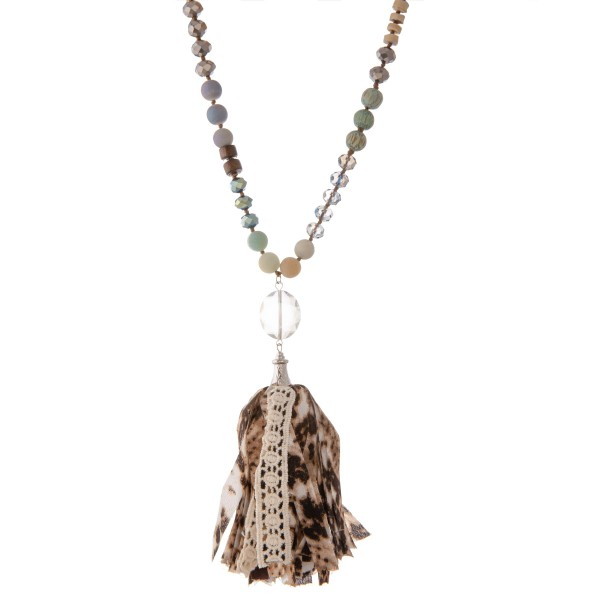 "Long semi precious beaded snakeskin fabric tassel statement necklace with crochet detail.  - Pendant approximately 5""  - Approximately 40"" L - 3"" extender"