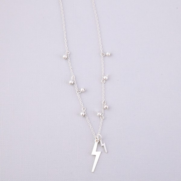 """Worn Silver sphere floater lightning bolt necklace.  - Pendant approximately 1.25""""  - Approximately 18"""" L overall - 3"""" extender"""